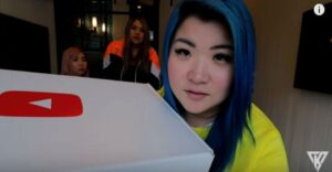 vlogger-itsfunneh-holding-box-from-youtube